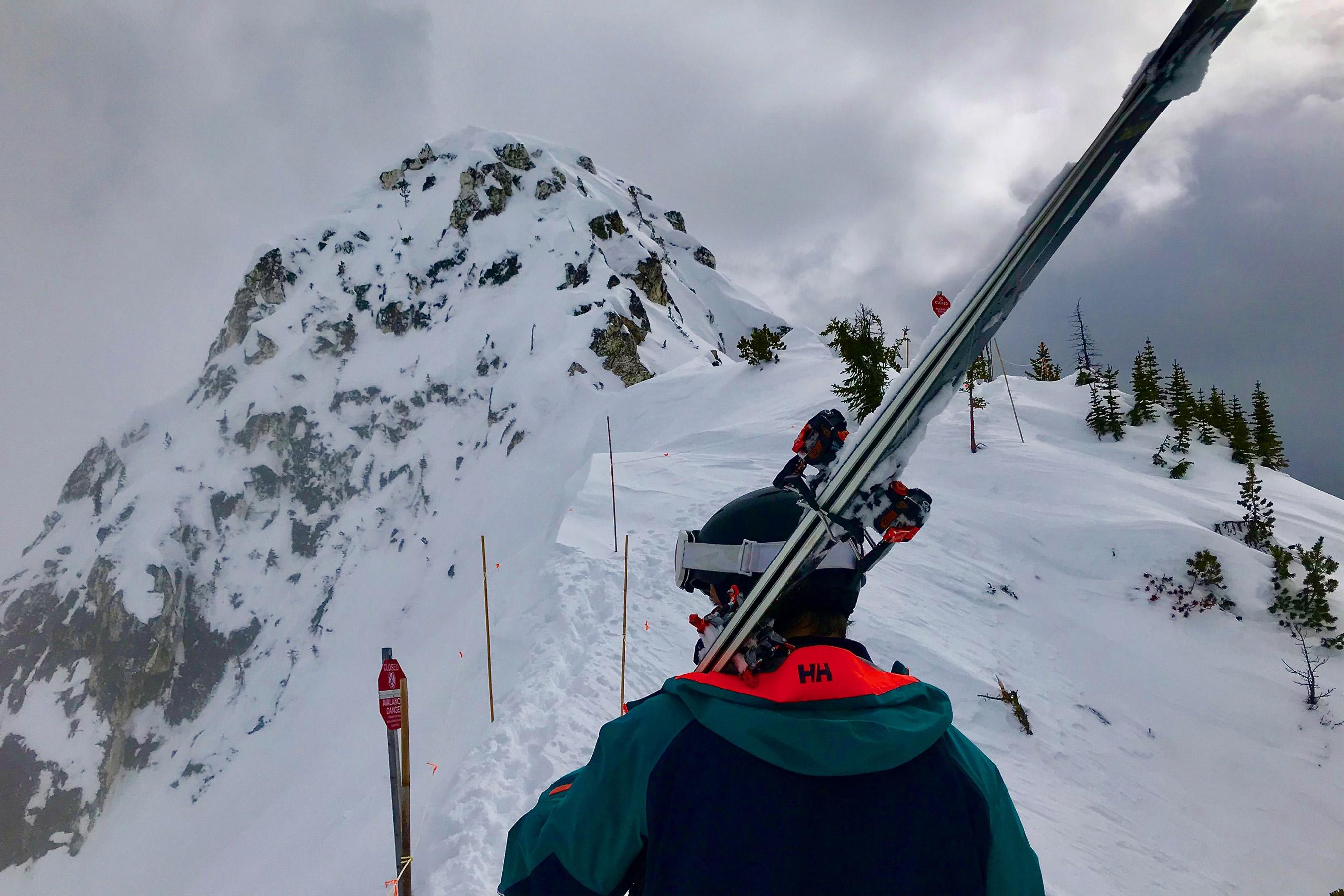 skier wearing hooded ski jacket