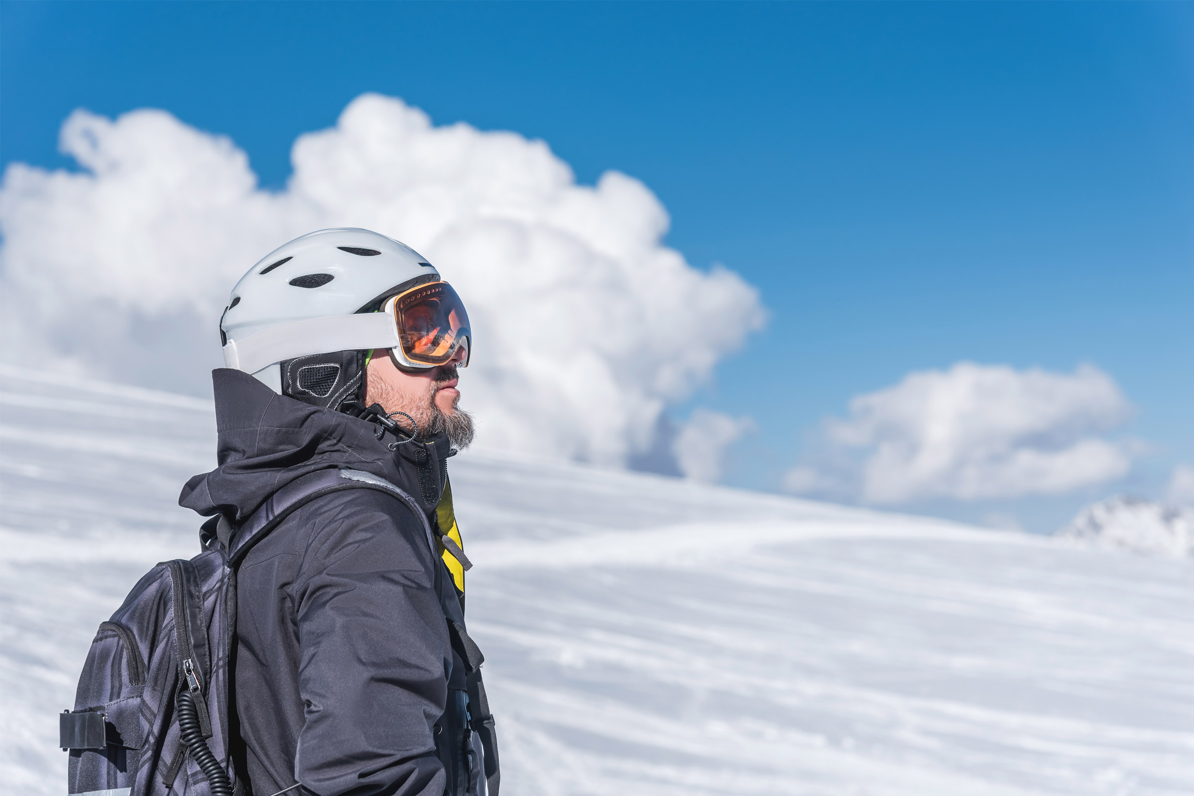 man wearing ski helmet and goggles