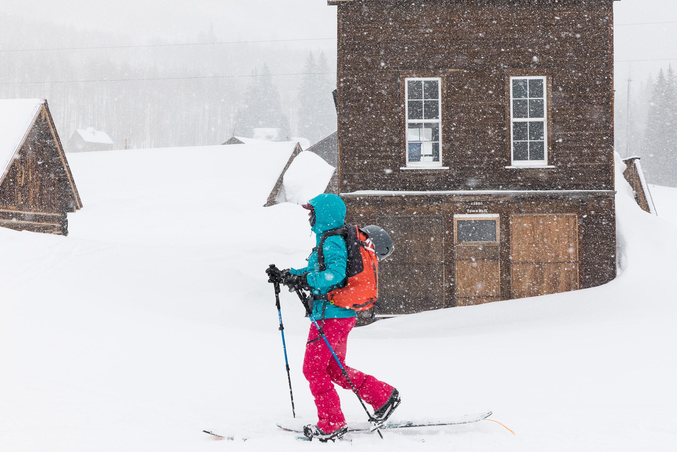 skier wearing winter jacket in snow