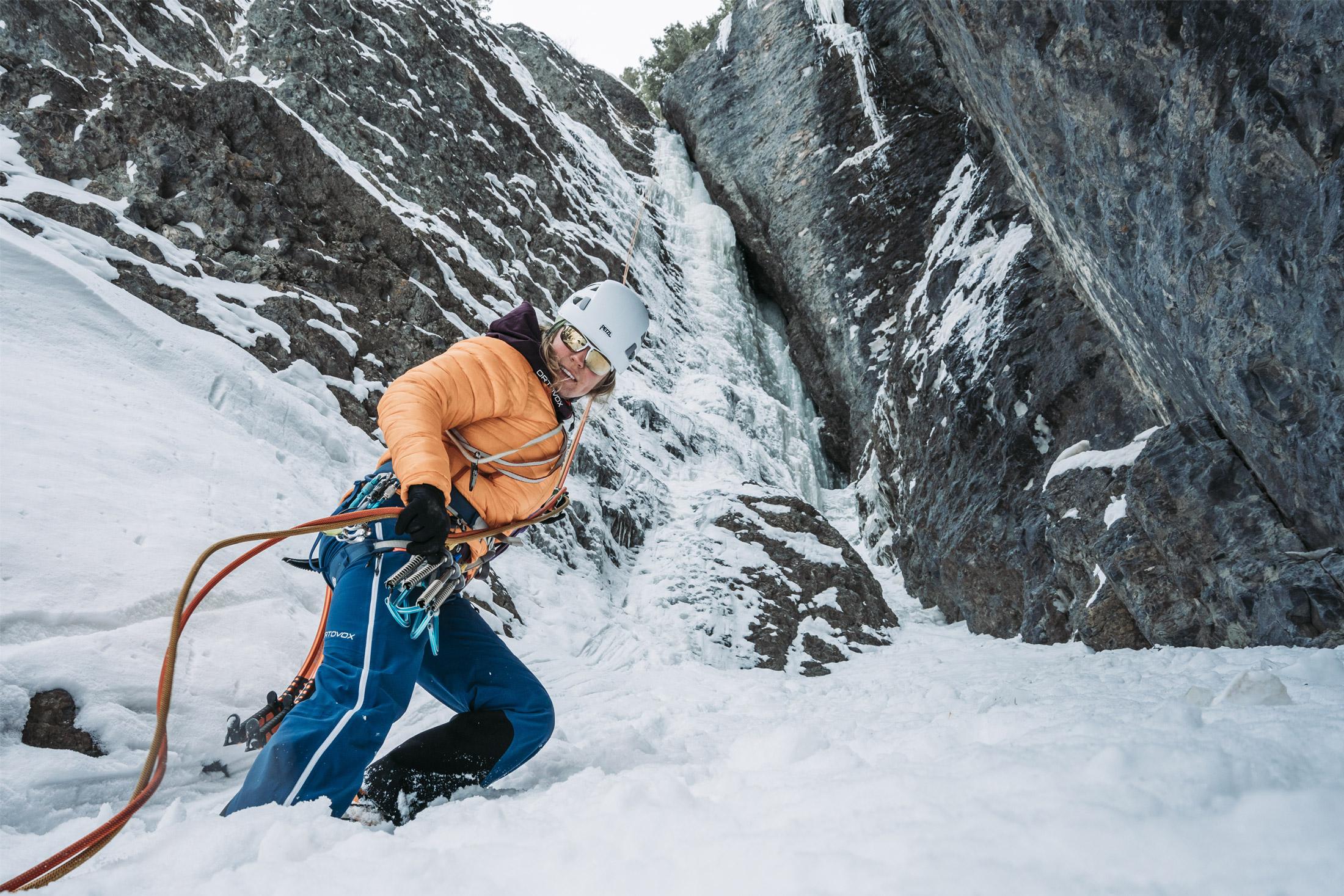 woman climbing while wearing winter jacket