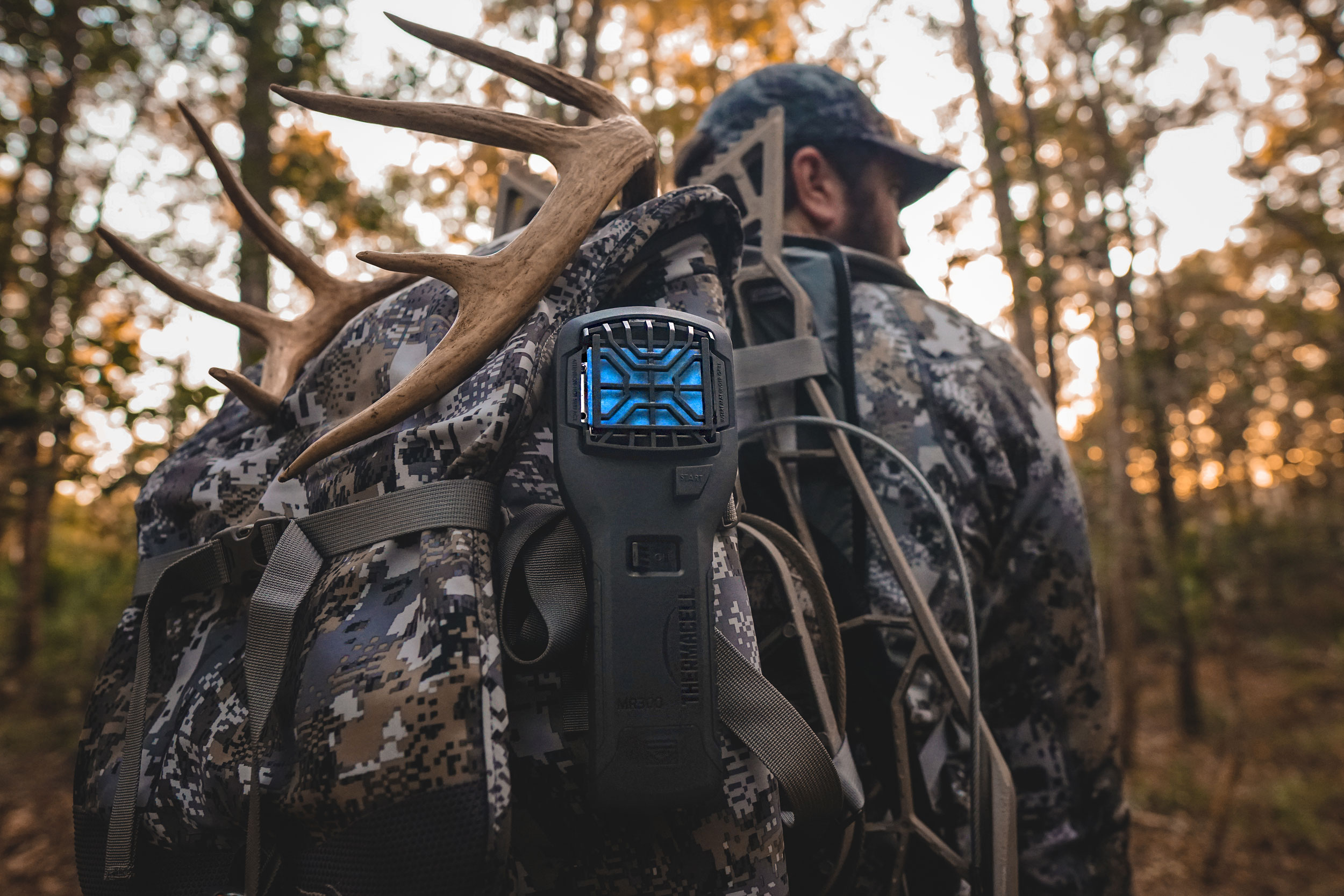 man carrying antlers on a sitka gear backpack with a thermacell mr300 attached