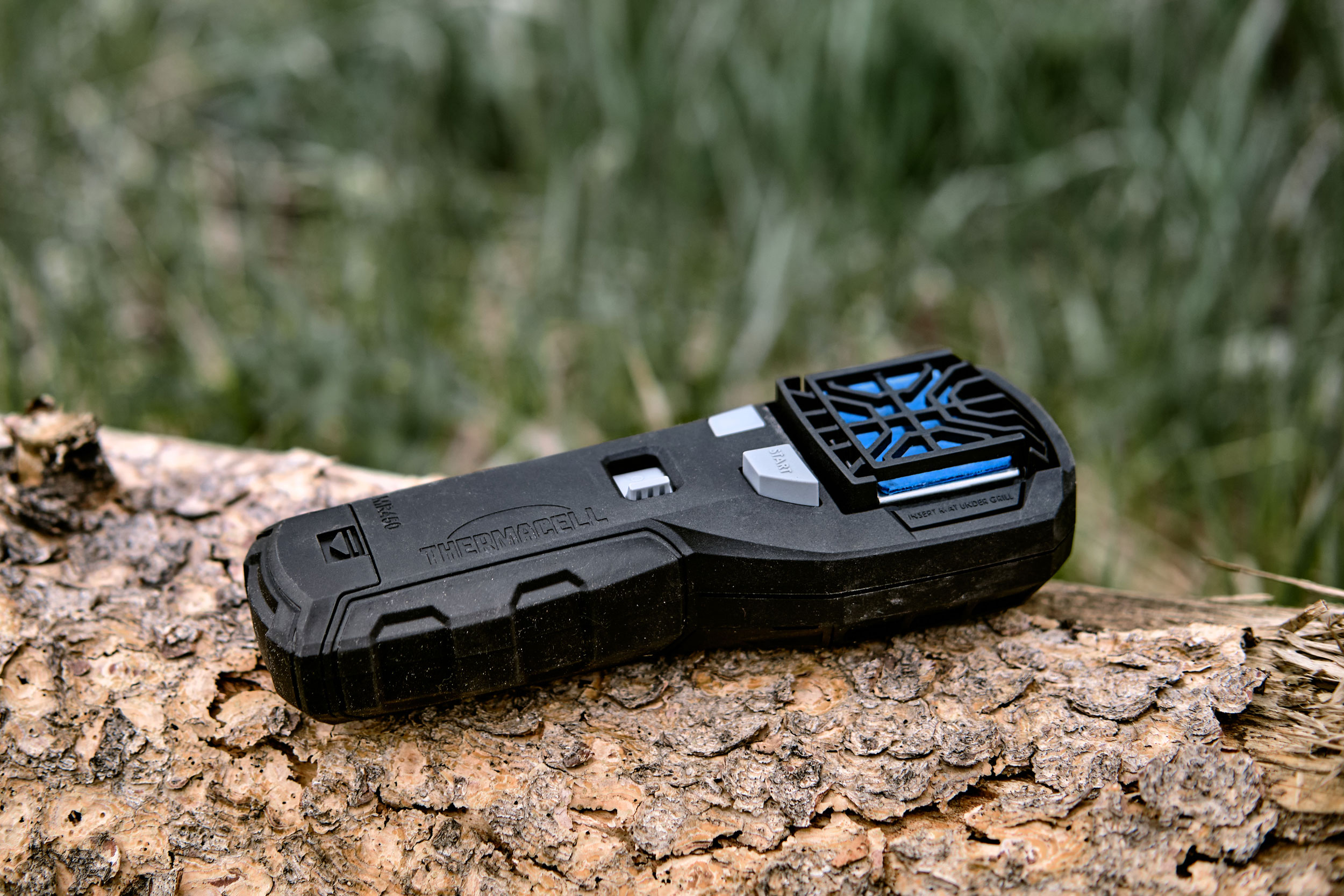 black thermacell mr450 on a log