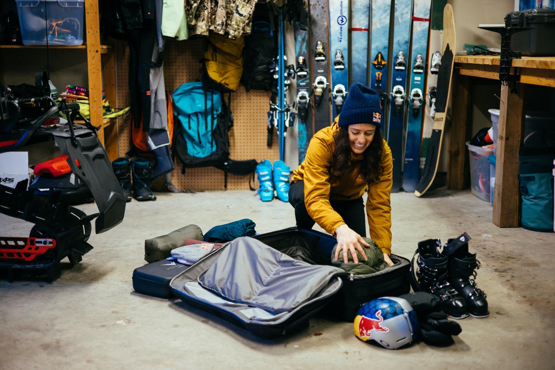 tatum monod packs ski gear for backcountry adventure