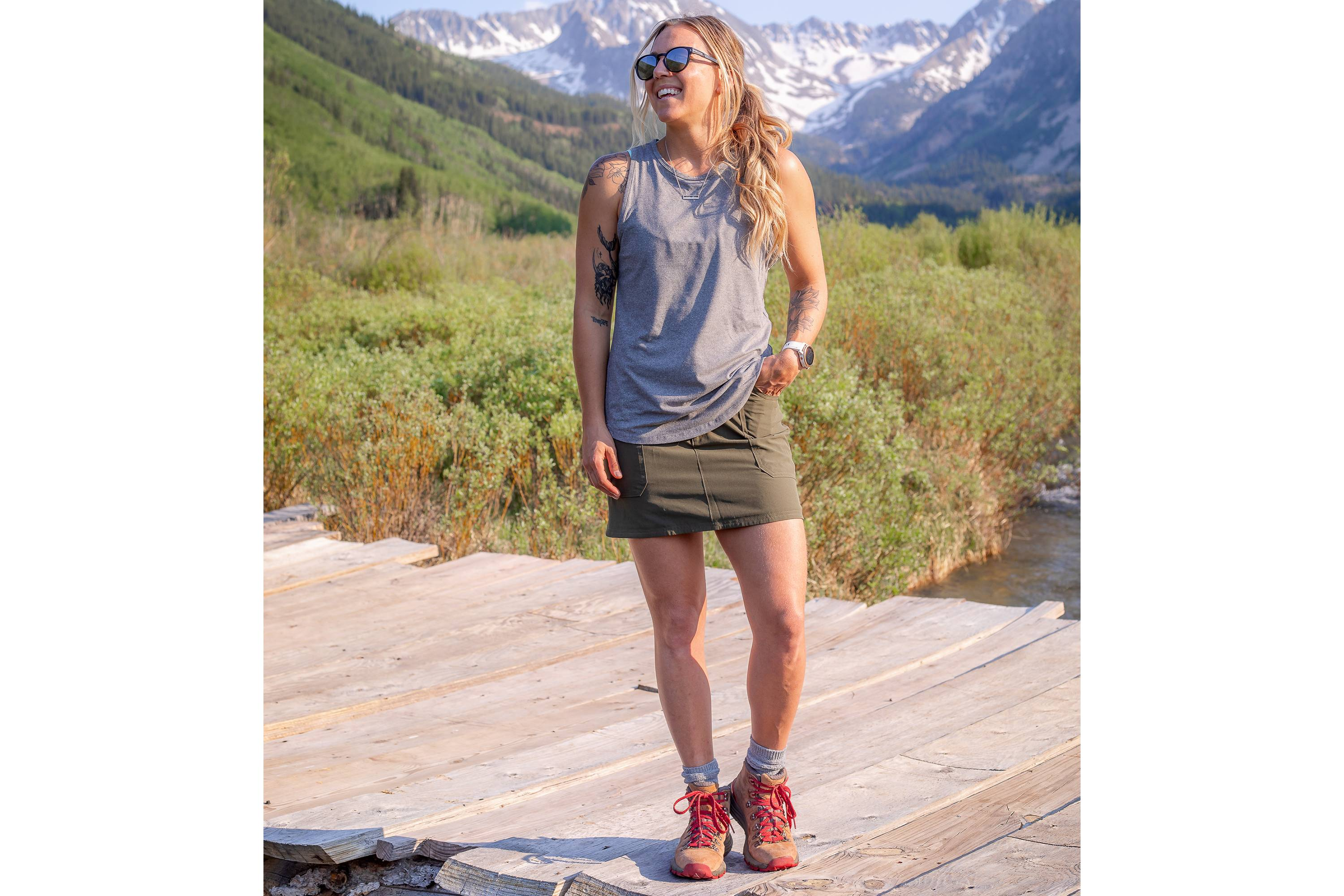 woman wearing wrangler skort standing outside in front of mountains