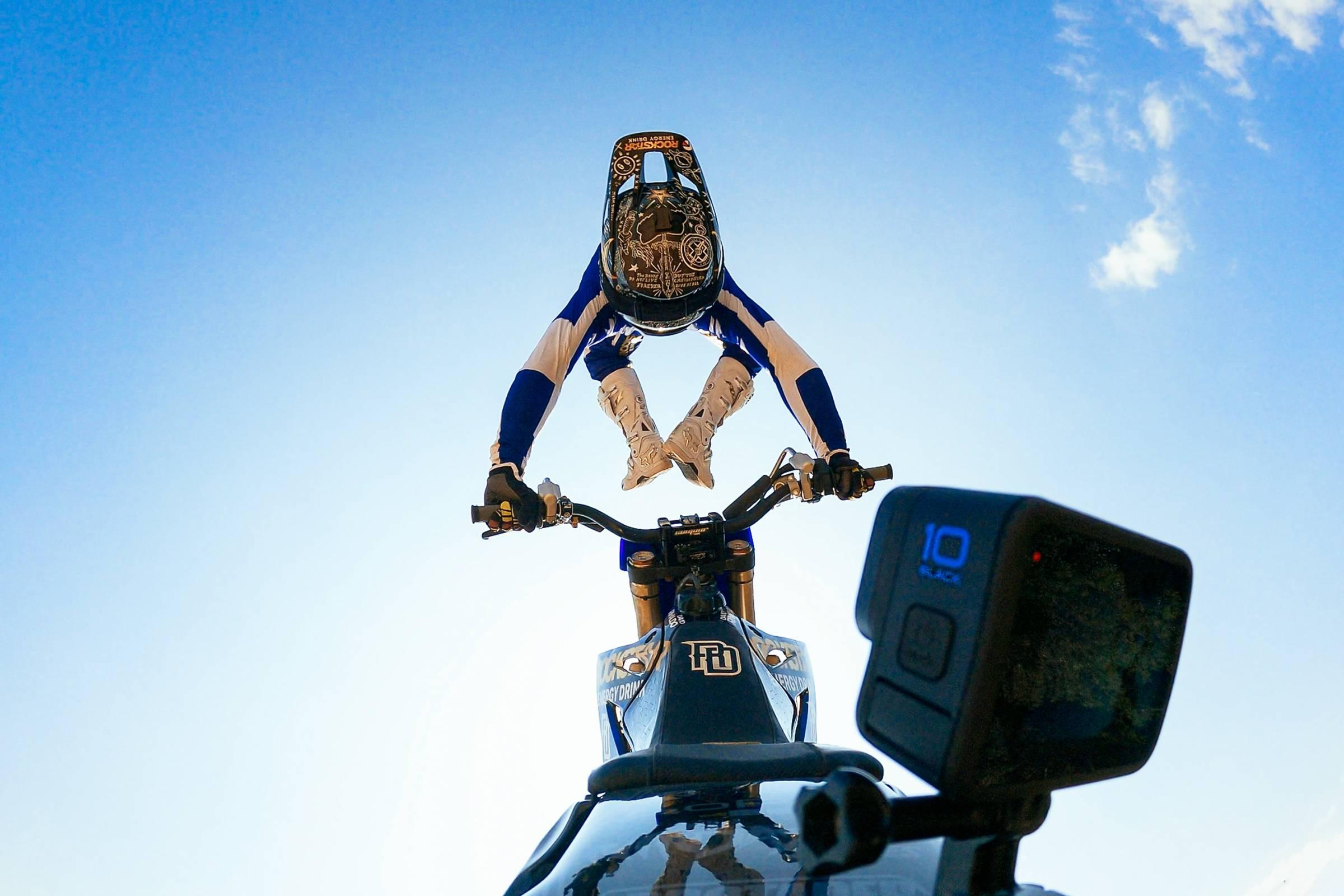 Moto rider back flipping with GoPro Hero10 Black