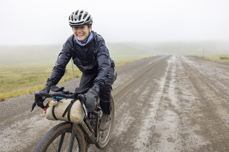 Lael Wilcox bikepacking along the Alaska Pipeline Road