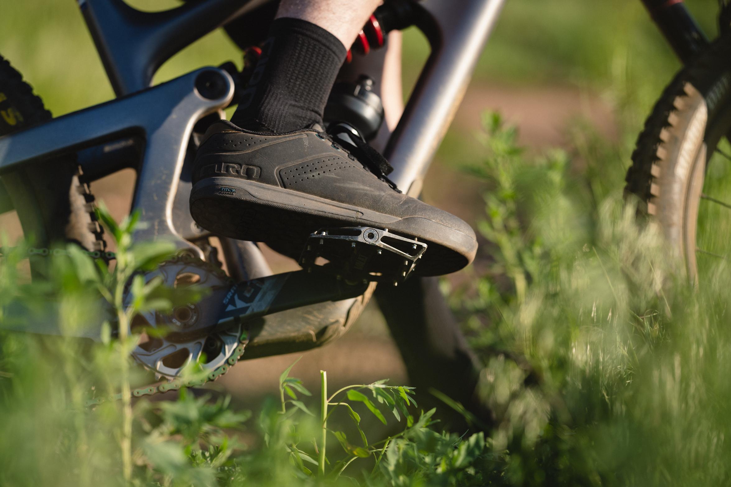 closeup of the Giro latch shoe on a mountain biker's foot