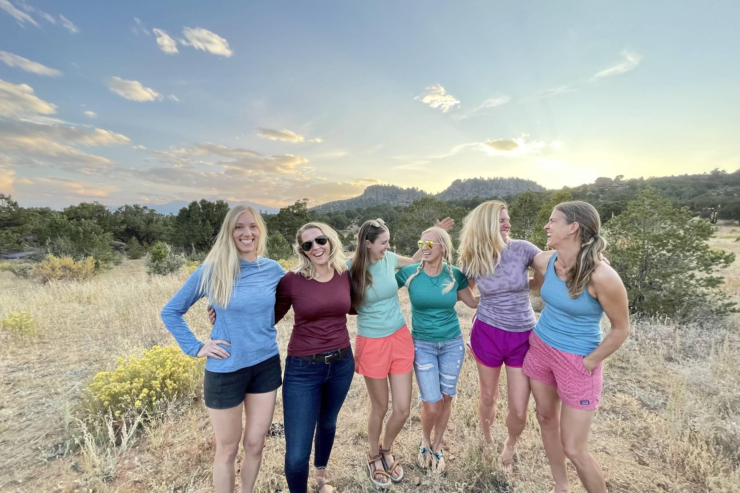 six women in six different styles of merino shirts