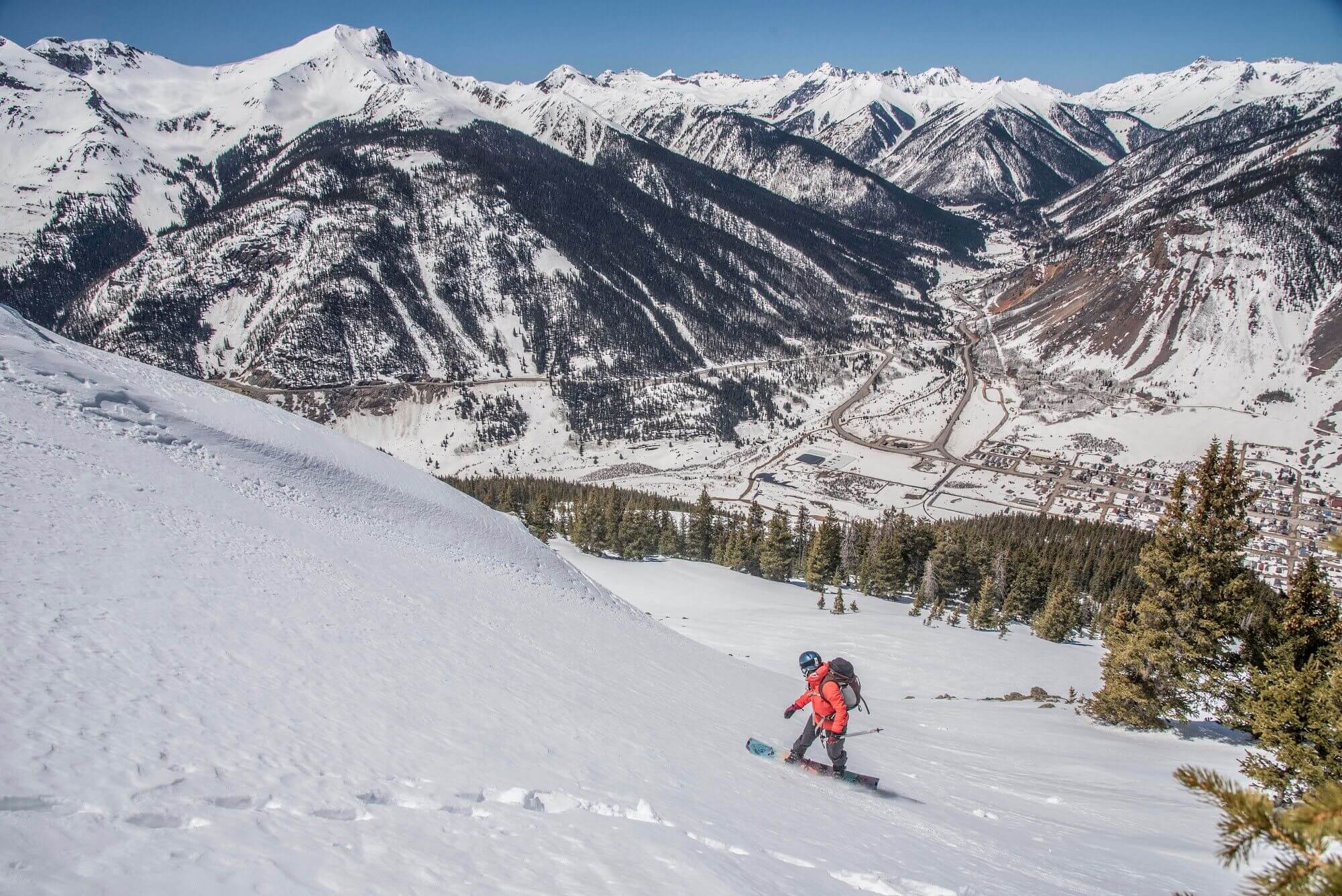 snowboarder riding snowboard on sunny winter day