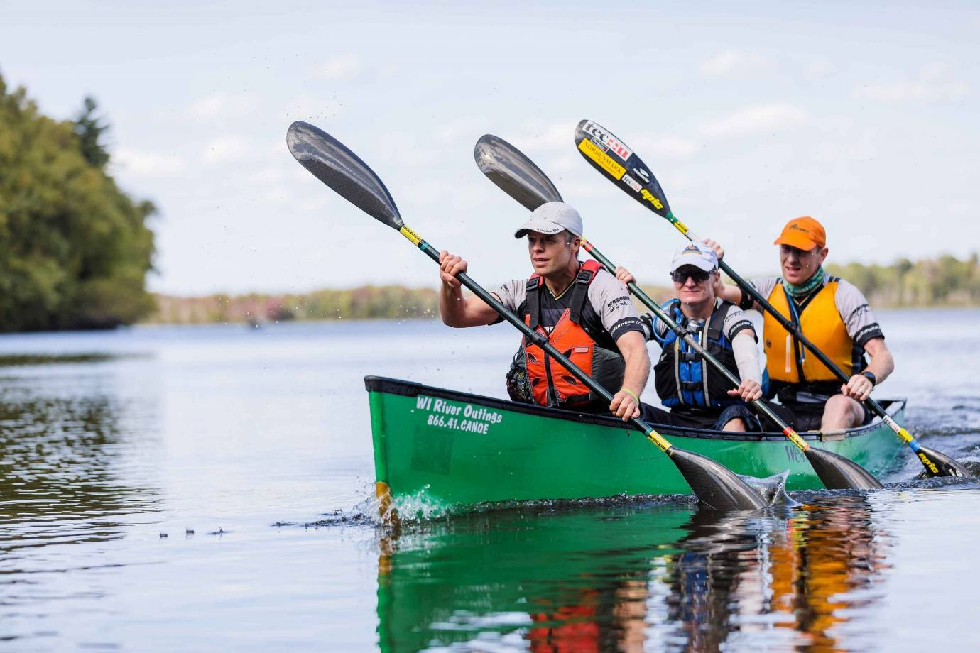 Team WEDALI paddles 25+ miles of open water during an early section in the USARA National Championship race
