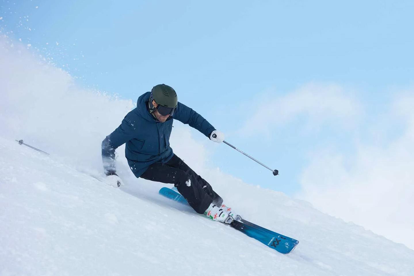 man skiing with volkl kendo 88 all-mountain skis