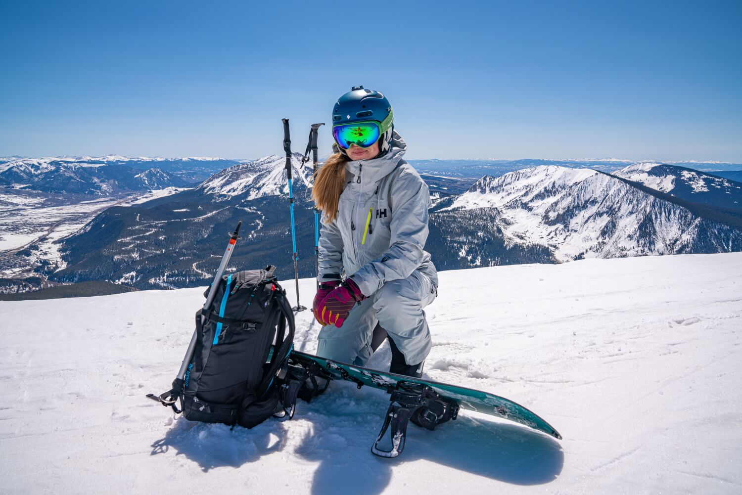 woman snowboarding on sunny winter day