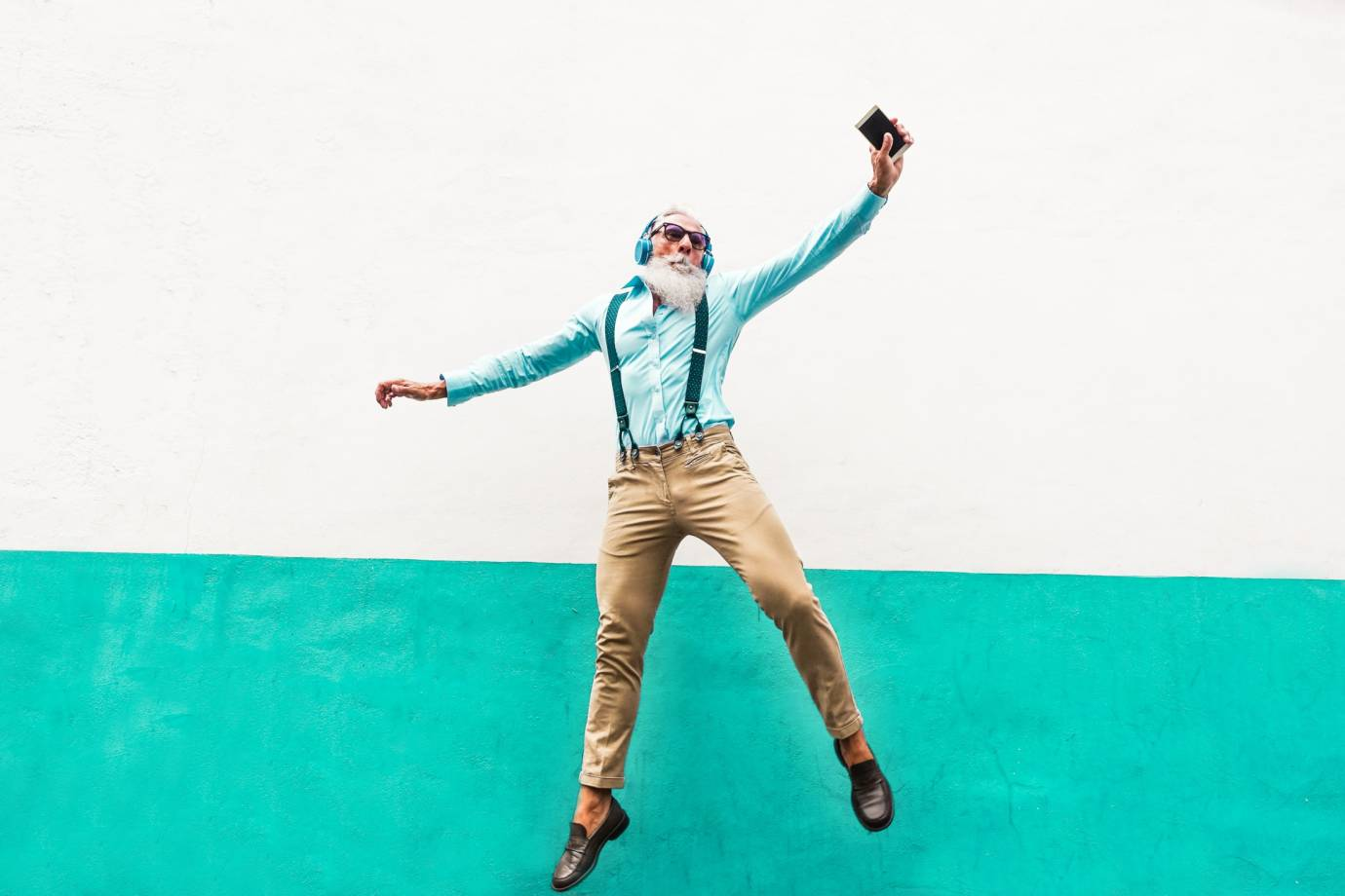 Dancing Man with Phone (photo Disobey Art Shutterstock)