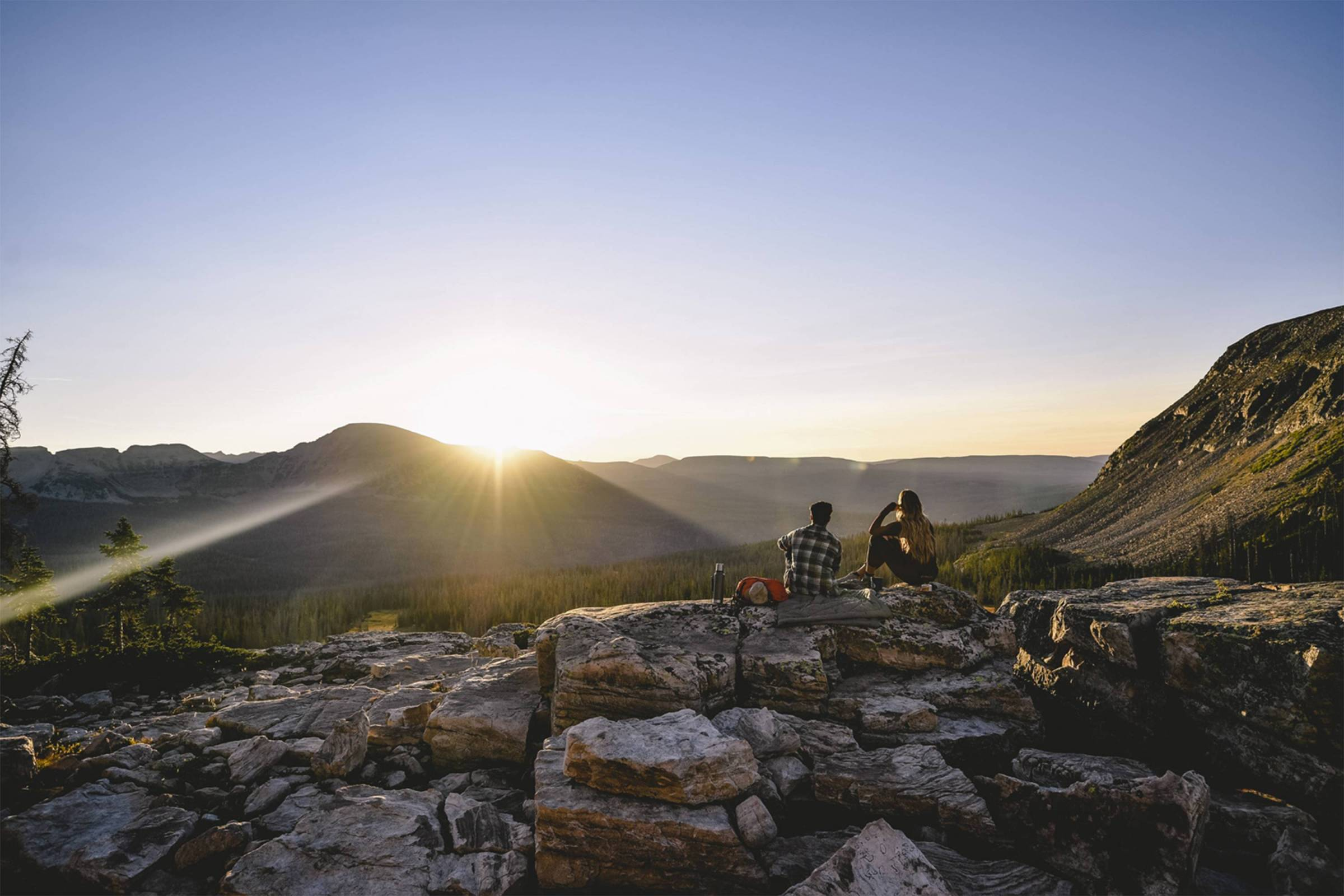 hikers overlooking mountains backcountry feature image sale article