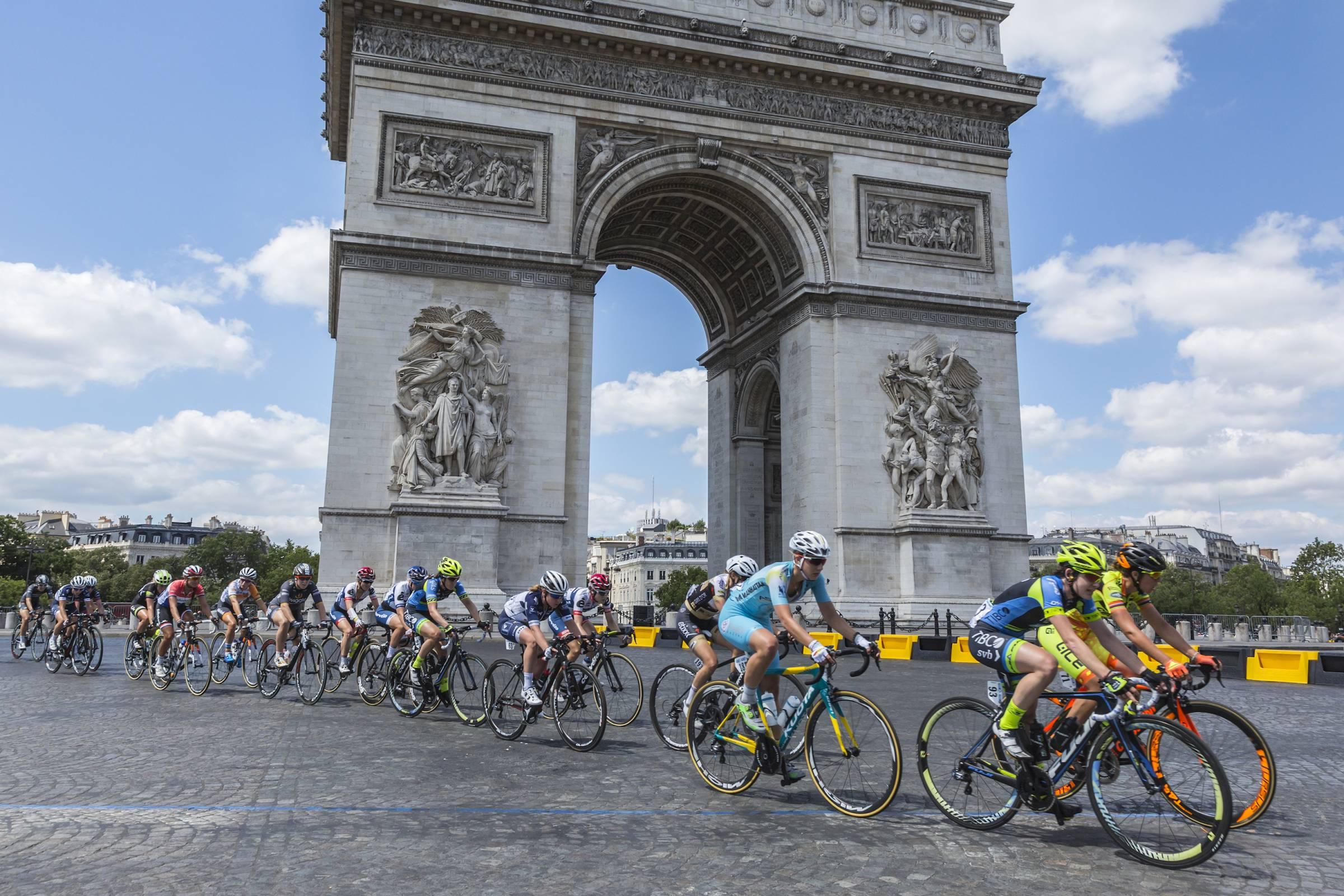 feminine peloton riding La Course in Paris, France