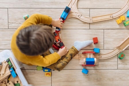 Child playing with a train set
