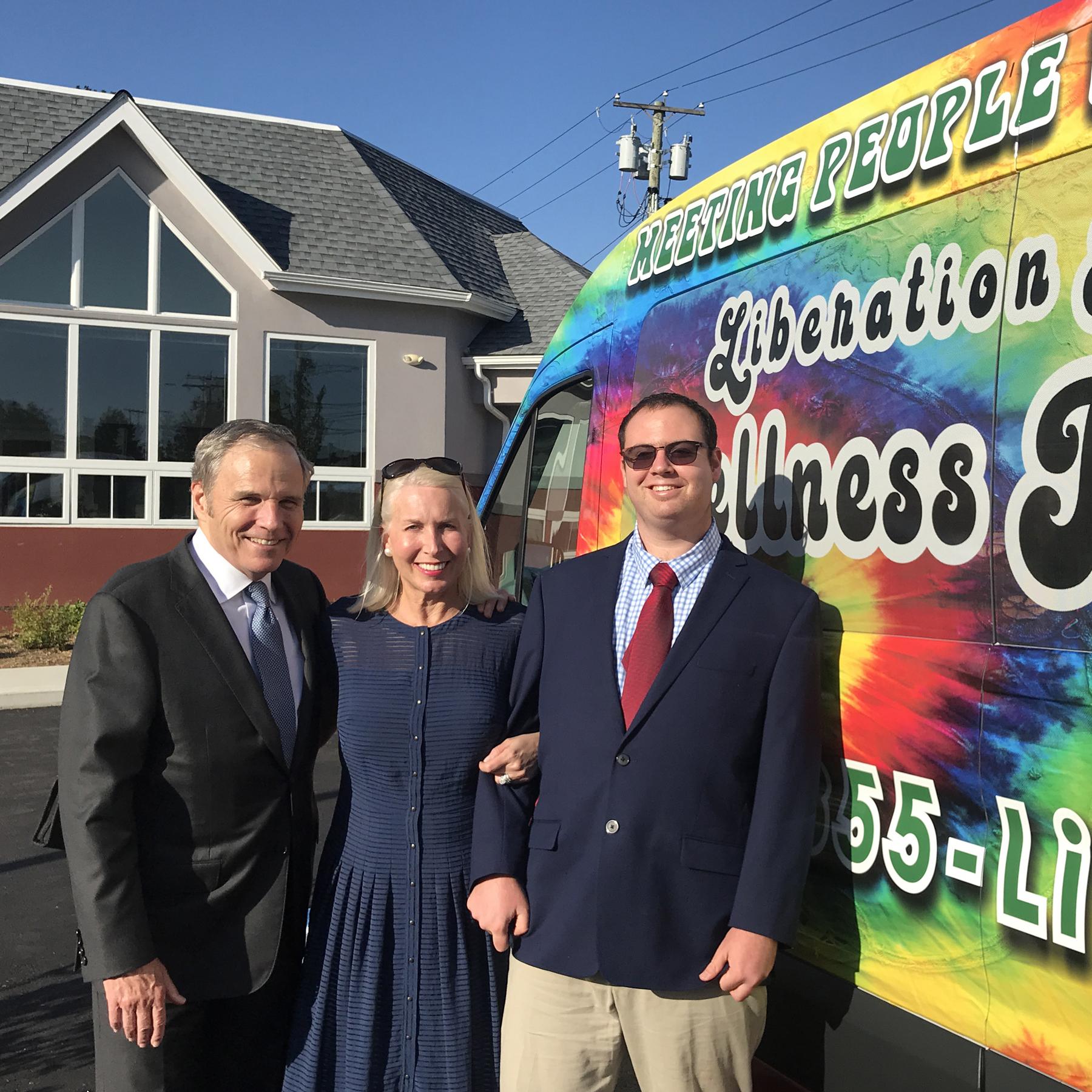 The Pelletiers in front of the Pelletier Wellness Center in Bridgeport, next to Liberation Programs' new Wellness Resource Van.