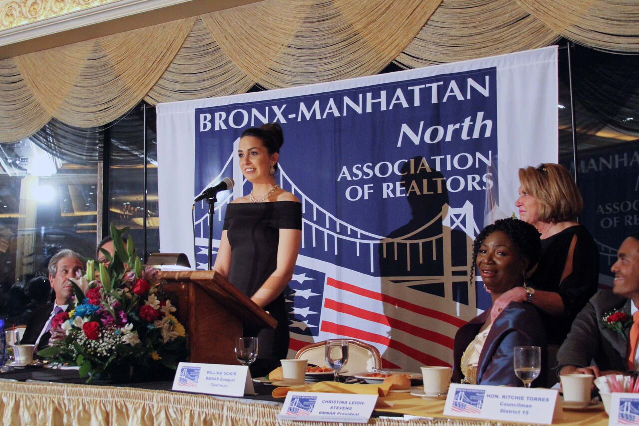 Gina Watson accepting her Realtor Associate of the Year Award at the the Bronx-Manhattan Association of Realtors at the organization's 93rd annual banquet.