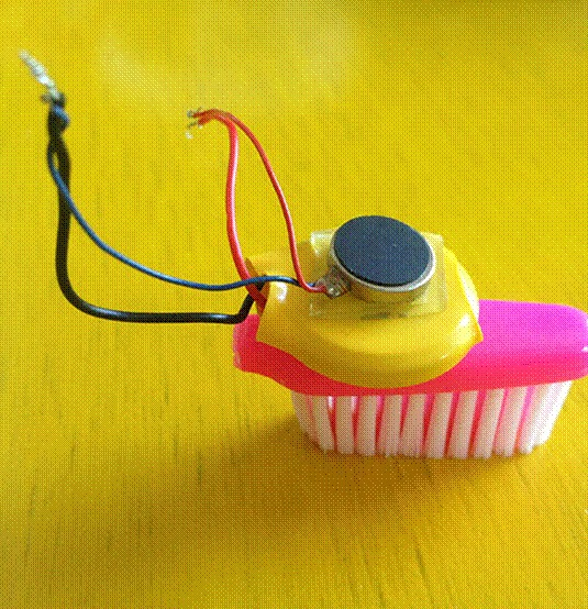 Close up of a brush bot created with a toothbrush