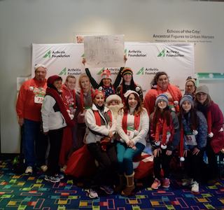 2019 adult Honoree Judy Marano and 2018 Adult Honoree Margaret Carey join Santa in raising money for arthritis research