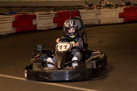 """A young event attendee takes advantage of """"Arrive and Drive"""" go-cart racing at Grand Prix New York and races toward a cure for pancreatic cancer and the 2nd annual event."""