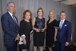 Stacey Tompkins of Tompkins Excavating accepts her Business Council of Westchester Award for Woman in Business Success. Left to right: James Giangrande, Elizabeth Bracken-Thompson, Stacey Tompkins, Marsha Gordon and Anthony Justic.