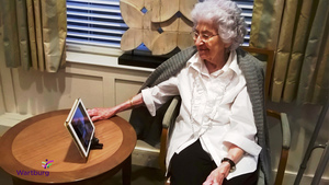 Wartburg resident having a virtual visit with family.