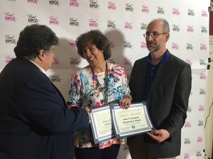 Cathy Ashe, director of food services from the Brewster Central School District, accepted heraward from Health Commissioner Michael Nesheiwat, left, and Shawn Rogan, public health sanitarian.
