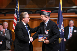 Sen. Harckham presents Art Hanley with plaque to commemorate his induction.