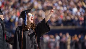 UNH Grad acknowledges the crowd at May 2019 Commencement