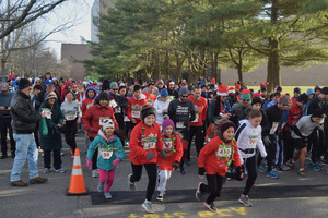 Participants in last years Jingle Bell Run at the starting line