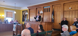 County Clerk Michael Bartolotti administers the Oath to new citizens