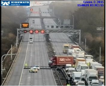 M1 J12-J13 cross over trapped traffic