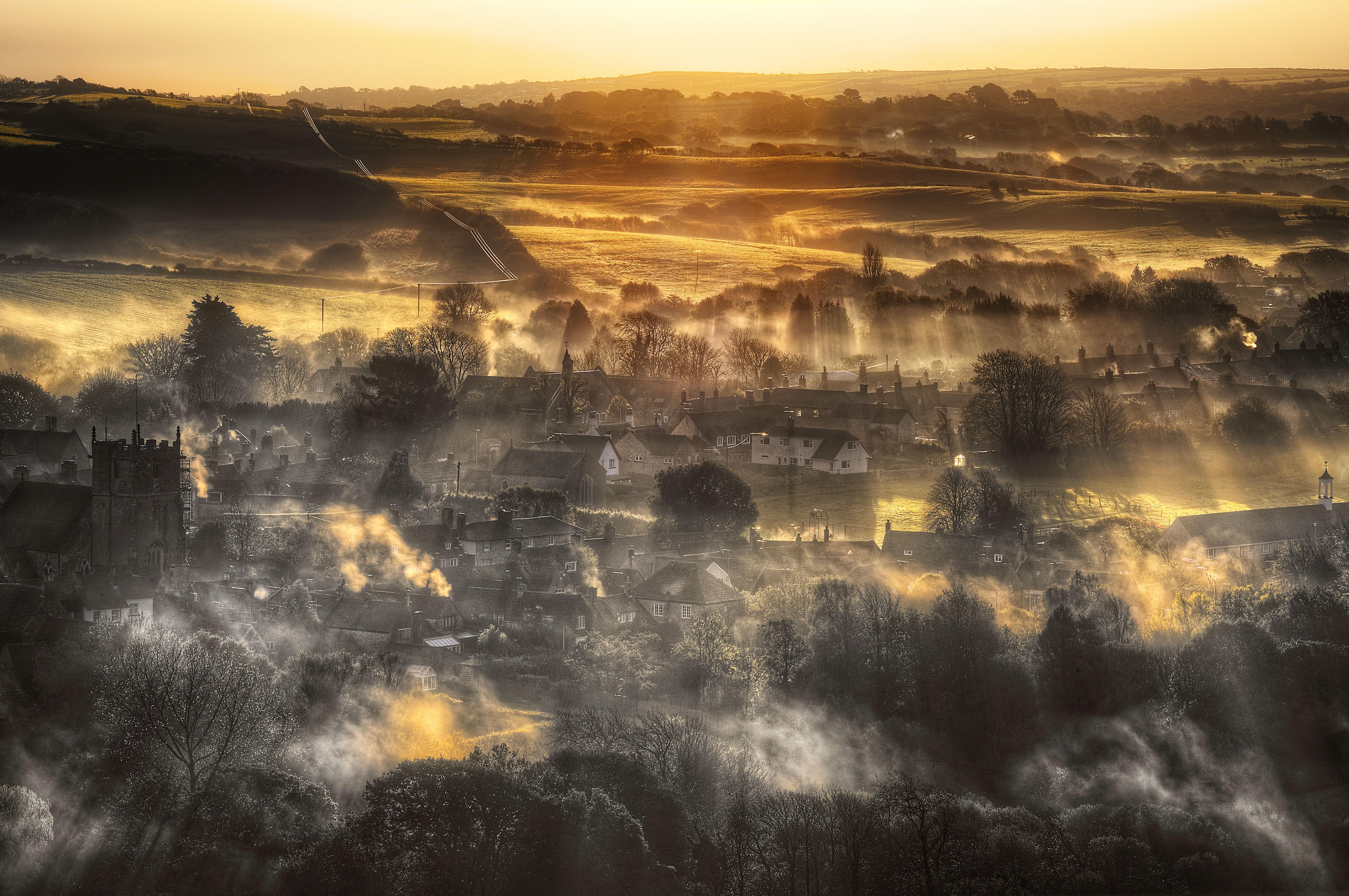 Morning Falls in Shards Over a Smoking Corfe