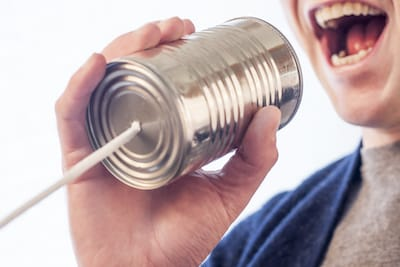 Man talking into can phone
