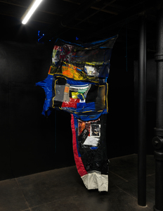 Bible The Day the Clown Cried Clothing, upholstery fabric, plastic, industrial fabric, canvas, spraypaint, acrylic, glue, book pages, found photographs, stickers, packing tape, nylon thread, nylon cord, acrylic rope, parachute cord, hand-sewing.