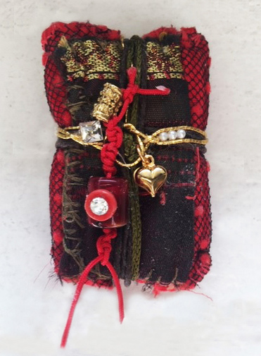 Ellen Devens Sculpture Made from Vintage textiles or Joomchi these handmade and sewn Healing and Memory Bundles are bound and corded with varying materials securing important elements, stones and embellishments.