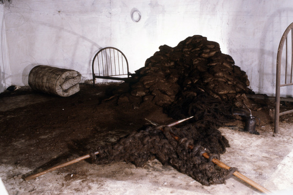 Janice Redman: Sculptor  Early Installations Mixed media with oiled oakum roping, knitted, earth wrapped in oiled paper.