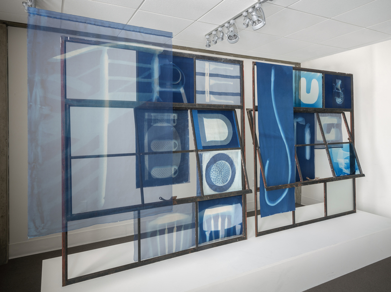 Leslie Hirst of rock and air cyanotype prints on silk, cotton and glass mounted to salvaged industrial window frames
