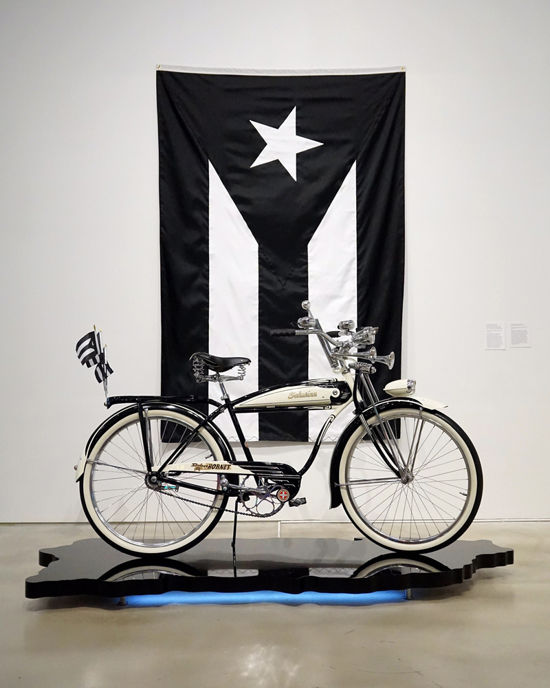 Miguel Luciano Ride or Die 1951 Schwinn Hornet, custom platform, LEDs, flags
