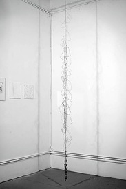 N a o m i  G r o s s m a n Sculptures wire words, suspended from ceiling
