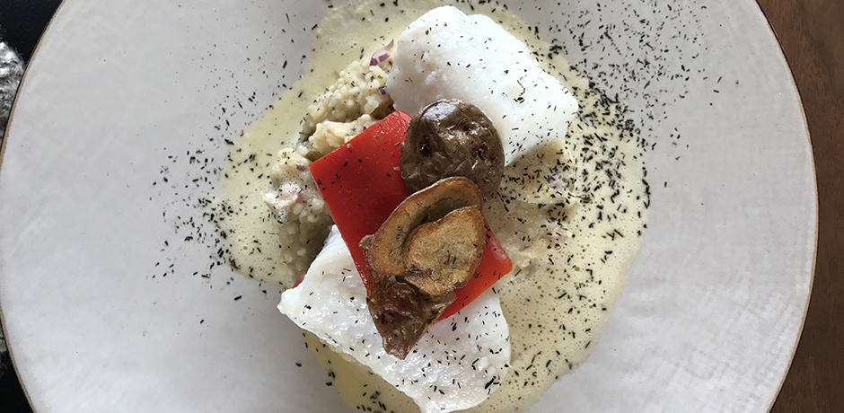 A delicious lunch of wolffish with mashed potato and roasted red peppers.