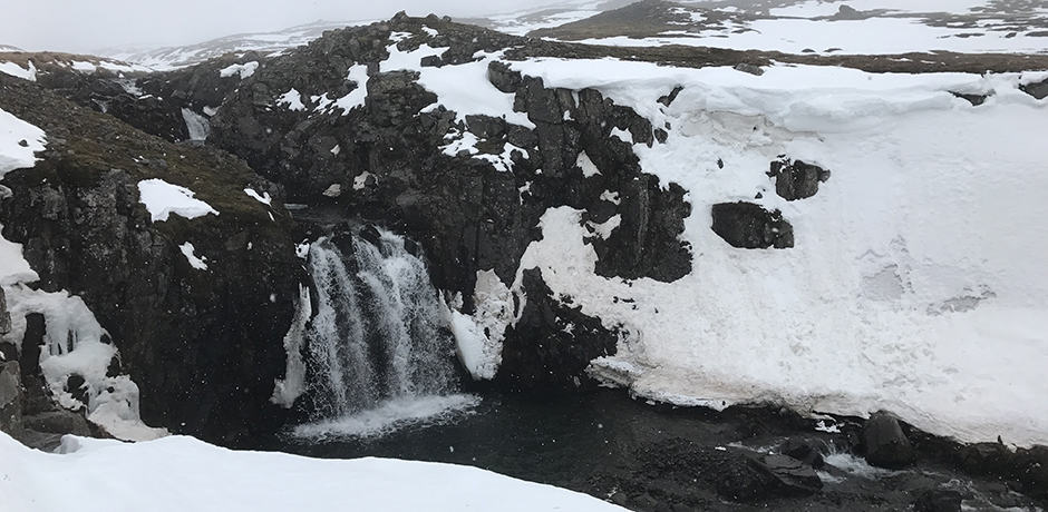 While snowmobiling around the area surrounding Deplar, we came across a beautiful waterfall.