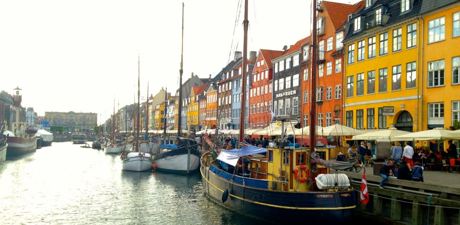Historic ships line the colorful Nyhavn canal in downtown Copenhagen