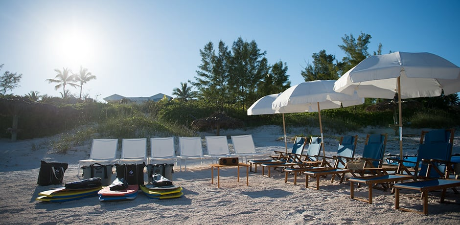 While the Bahama House is not beachfront, it is a short golf-cart ride to this charming setup on the pink sand beach (photo credit Alex Fenlon)