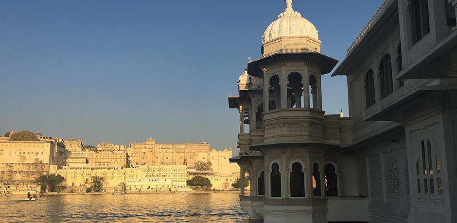 Admiring a view of Udaipur's City Fort from the Taj Lake Palace