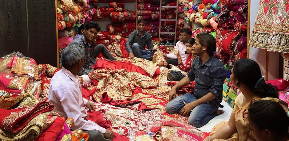 Wedding shopping for traditional red saris in Jaipur's bustling Johari Bazaar