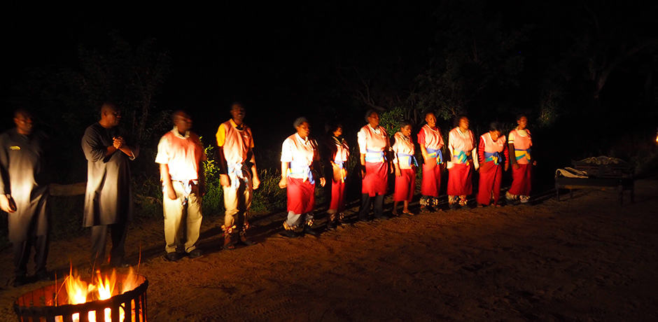 The staff at Royal Malewane entertain guests during dinner in the bush