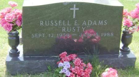 ADAMS, RUSSELL E.