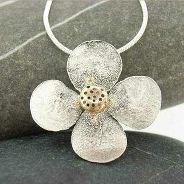 Reticulation on silver flower pendant